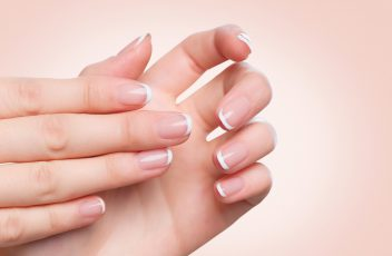 Beautiful Woman Hands. Female hands with french manicure.