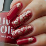 Scarlett red nail polish with gold leaf nail art