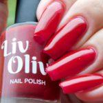 Scarlett red nail polish closeup