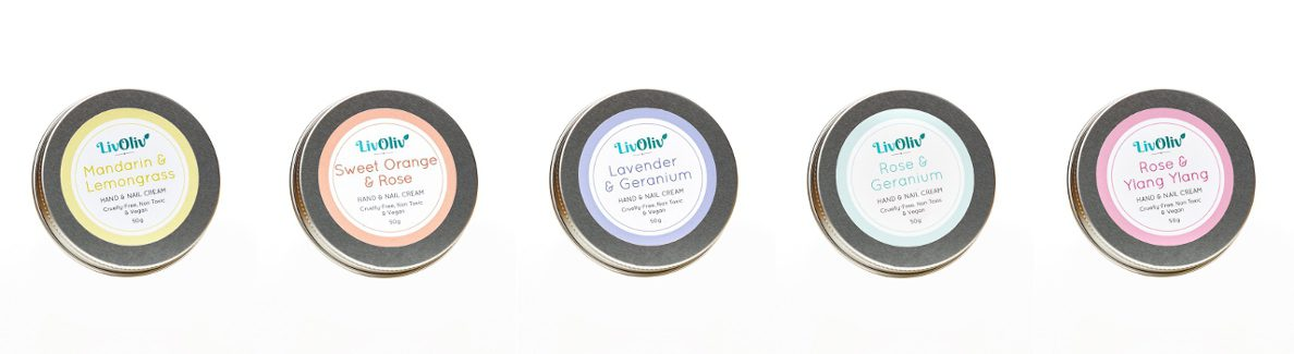 Row of 5 scented handmade cruelty free, non toxic and vegan hand cream in silver metal tins